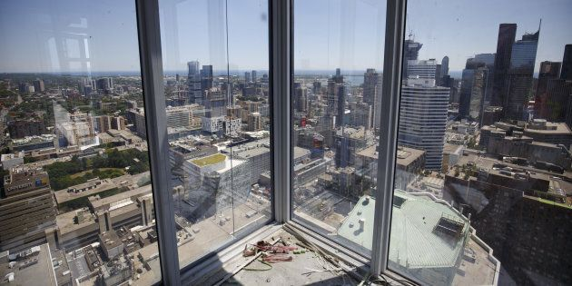 The city skyline is seen from an apartment building under construction in Toronto on July 10.