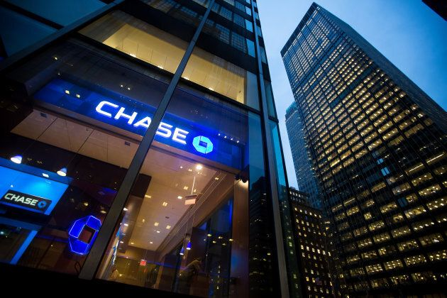 JPMorgan Chase & Co. signage is displayed at a bank branch, left, across from its Park Avenue headquarters,...