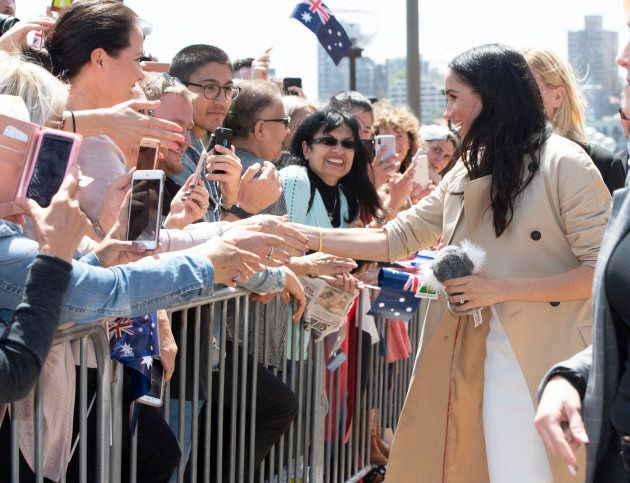 The duchess shakes hands with the public.