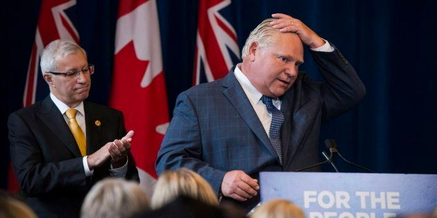 Ontario Premier Doug Ford speaks to members of his caucus in Toronto on Sept. 24,