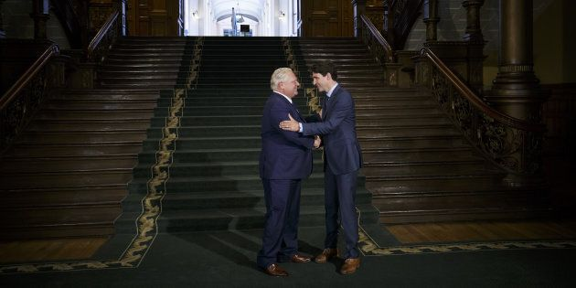 Ontario Premier Doug Ford shakes hands with Prime Minister Justin Trudeau in Toronto on July 5,