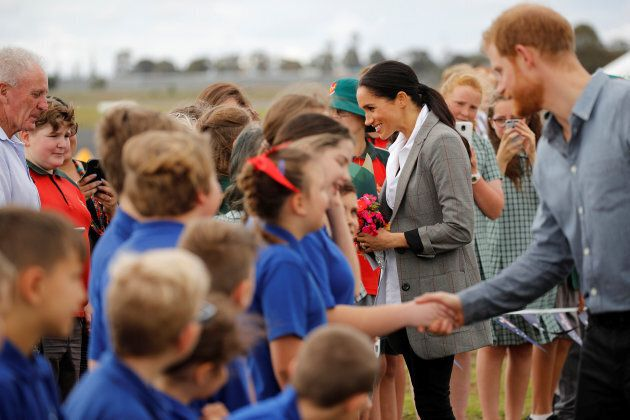 The Duke and Duchess of Sussex interact with children from Dubbo South Public School after arriving at...