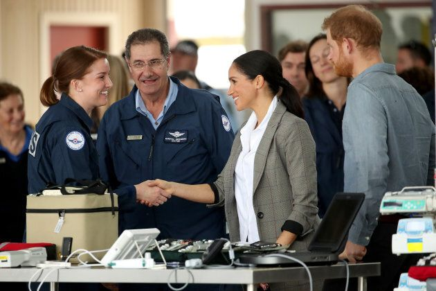 The Duke and Duchess of Sussex meet with health workers at the Royal Flying Doctors Service hangar on Wednesday.