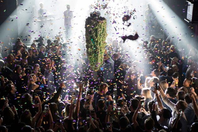 A depiction of a cannabis bud hangs from the ceiling as a band plays at Leafly's countdown party in Toronto, Tuesday, Oct. 16, 2018, as they prepare to mark the legalization of Cannabis across Canada. (Chris Young/The Canadian Press via AP)