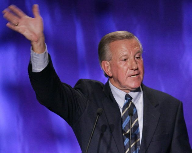 Ernie Eves waves as he leaves the stage following a speech at the Ontario PC leadership convention in...