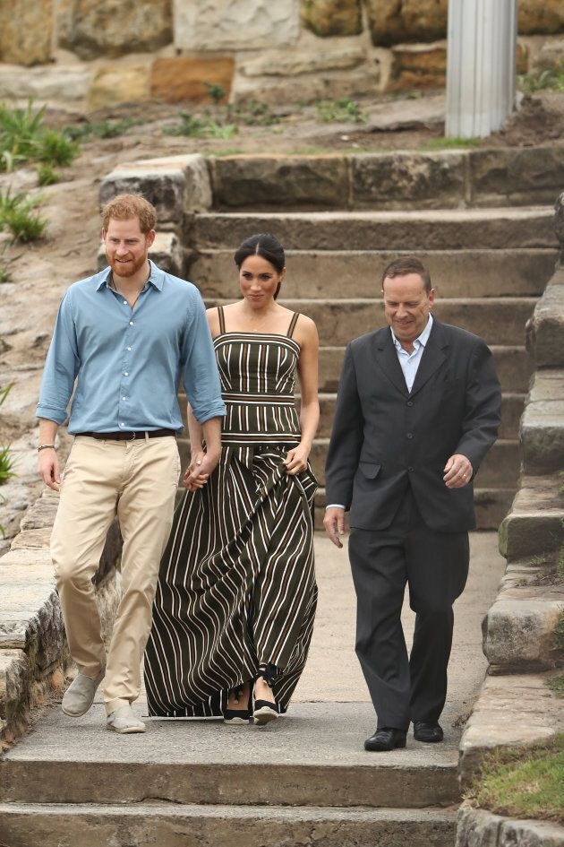 Prince Harry and and Meghan, Duchess of Sussex walk down to Bondi Beach with Waverley Mayor John Wakefield on Friday, Oct. 19, 2018 in Sydney, Australia.