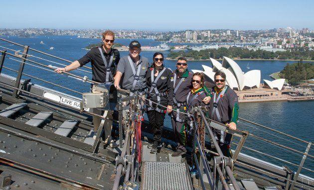 Prince Harry, Australia's Prime Minister Scott Morrison and Invictus Games representatives climbing the Sydney Harbour Bridge.