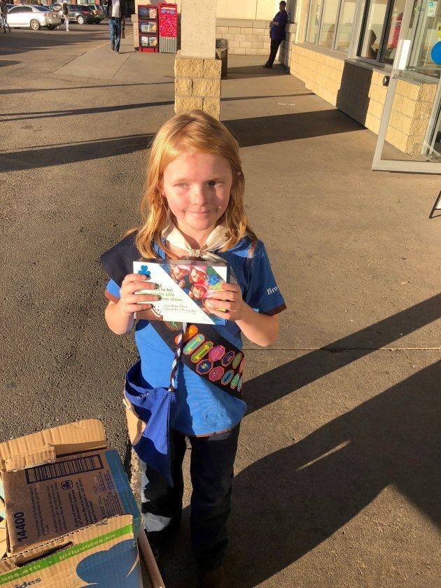 Nine-year-old Elina Childs poses as she sells Girl Guide Cookies outside a cannabis store in Edmonton...