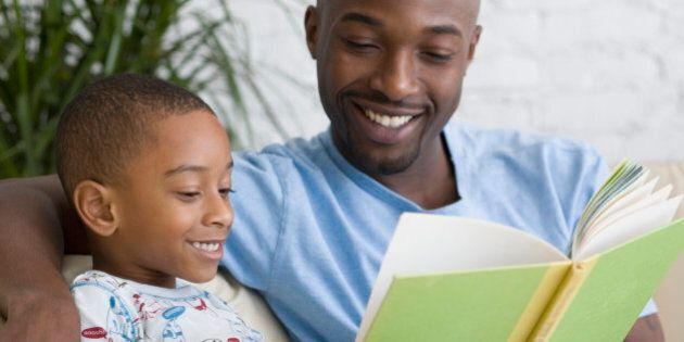 African father and son reading