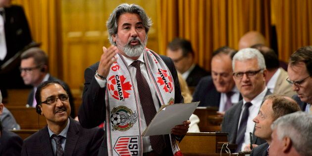 Pablo Rodriguez sports a soccer scarf as he delivers a statement in the House of Commons on June 13,