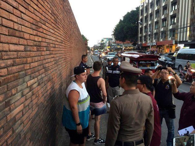 British Furlong Lee and Canadian Brittney Lorretta Katherine Schneider stand in front of Tha Pae Gate...