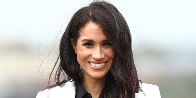 Meghan, Duchess of Sussex, smiles during the JLR Drive Day at Cockatoo Island on Saturday in Sydney, Australia.