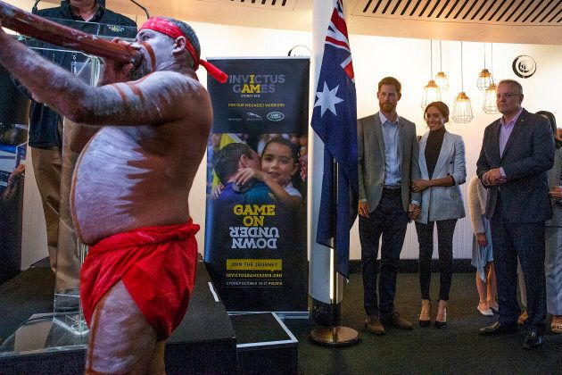 Harry and Meghan attend a lunchtime reception hosted by Prime Minister Scott Morrison with Invictus Games competitors and representatives of the community in the city's central parkland, The Domain in Sydney, on Sunday.