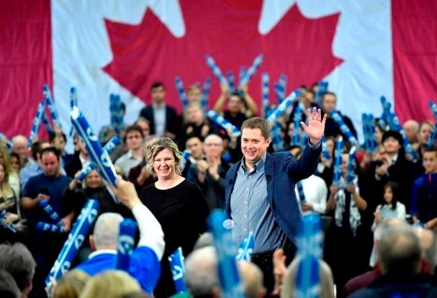 Conservative Leader Andrew Scheer waves to supporters as his wife Jill joins him on stage, following...
