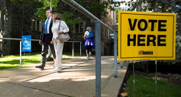 Toronto Mayor John Tory accompanies his mother Elizabeth Tory to vote at an advanced polling election...