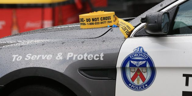 Police tape sits atop a Toronto police