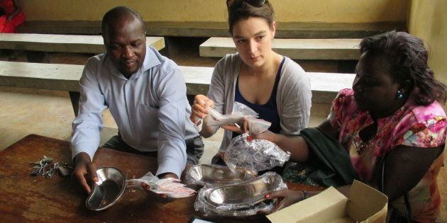 Christina Hassan works alongside health workers at the Mukono Health Centre in Uganda in