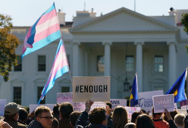 The National Center for Transgender Equality, NCTE, and the Human Rights Campaign gather in front of the White House in Washington on Monday for a #WontBeErased rally.