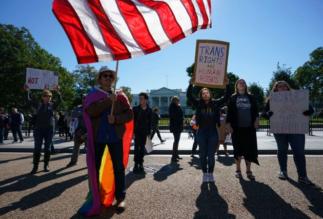 The National Center for Transgender Equality, NCTE, and the Human Rights Campaign gather in front of the White House on Monday for a #WontBeErased rally.