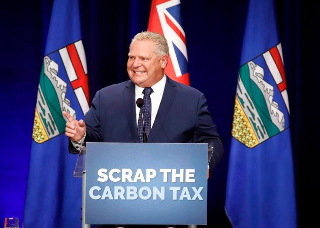 Ontario Premier Doug Ford speaks to supporters at an anti-carbon tax rally in Calgary on Oct. 5,