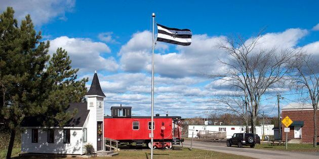 A flag, approved by the village council, flies in Chipman, N.B. on Oct. 22,