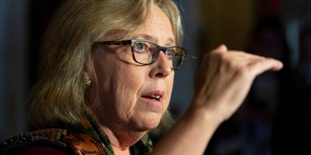 Green Party Leader Elizabeth May speaks with the media in the Foyer of the House of Commons on Parliament...