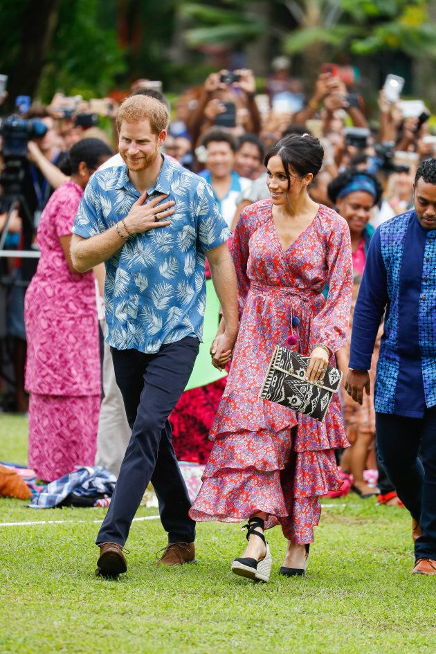 Prince Harry and Meghan Markle arrive at University of the South Pacific on Wednesday in Suva, Fiji.