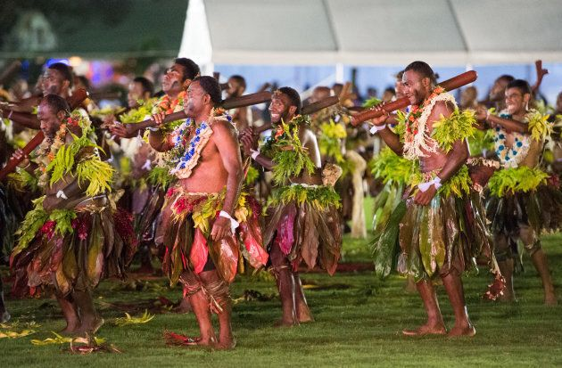 Suva locals take part in an official welcome ceremony in the city centre's Albert Park for Meghan and Harry on Tuesday.