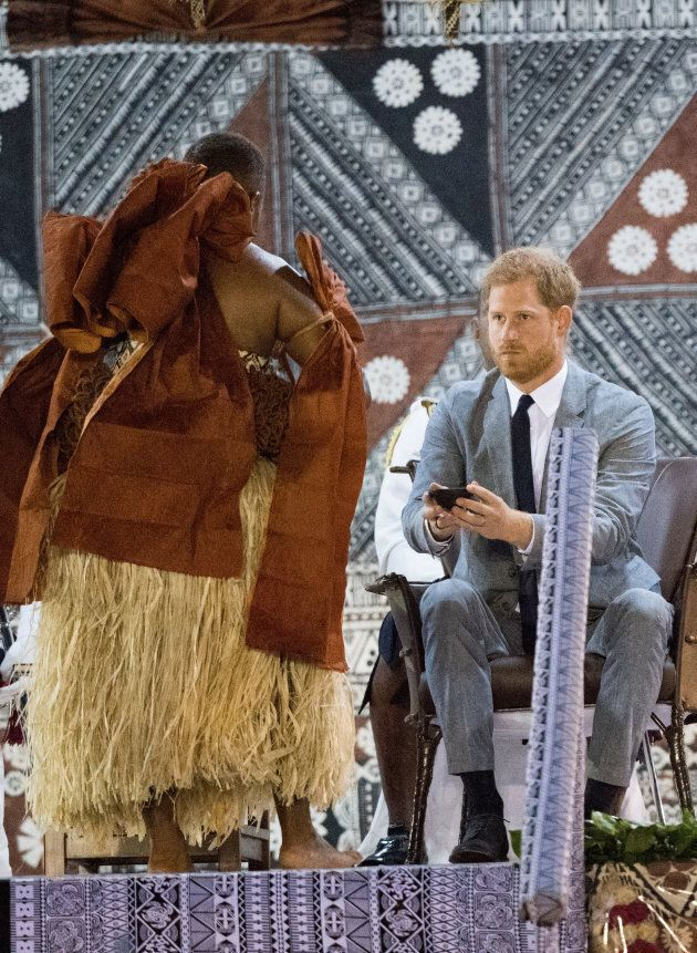 Prince Harry takes a sip of Kava, the national drink of Fiji.