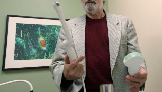 A doctor holds a transvaginal ultrasound device, left. The procedure is painful and often