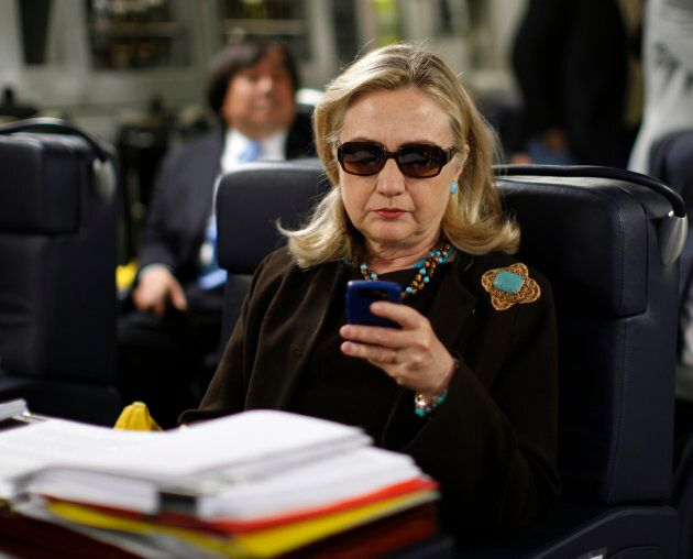 This Oct. 18, 2011 photo of then-Secretary of State Hillary Rodham Clinton checking her Blackberry inspired...
