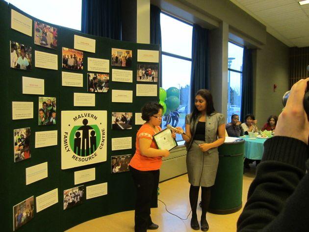 Enrica receiving an award for