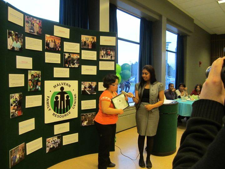 Enrica receiving an award for volunteering.