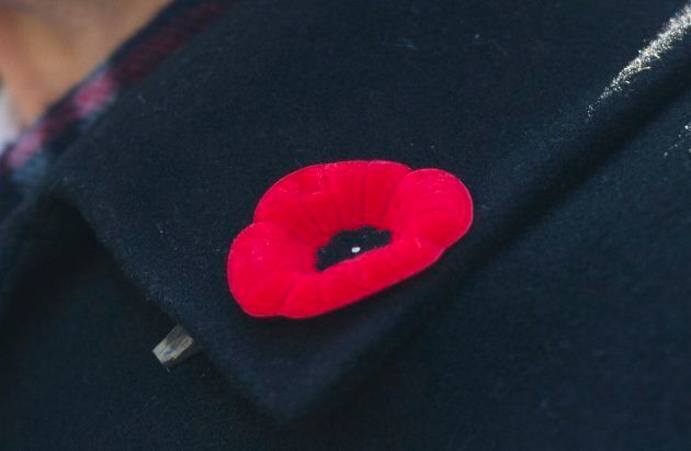 A veteran wears a poppy on his lapel during a Remembrance Day ceremony in Montreal on Nov. 11,