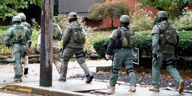 A SWAT team arrives at the Tree of Life Synagogue where a shooter opened fire injuring multiple