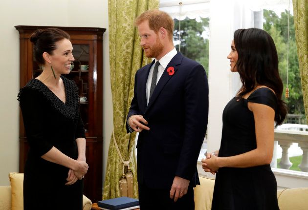 Jacinda Ardern speaks with Prince Harry and Meghan Markle at Government House in Wellington on Sunday.