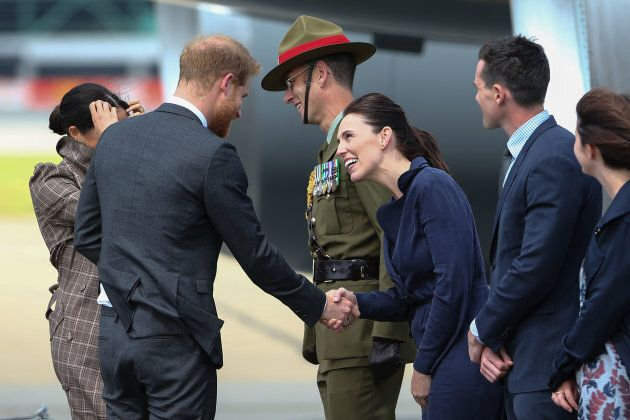Prince Harry and Meghan Markle are welcomed by New Zealand's Prime Minister Jacinda Ardern (third from the right) as they arrive at the Wellington International Airport Military Terminal on Sunday.
