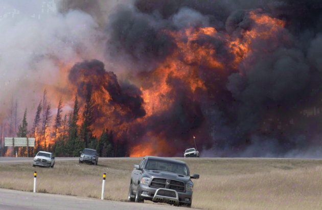 Wildfire rips through the forest south of Fort McMurray, Alta., on May 7,
