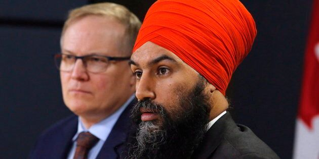 NDP MP Peter Julian and party leader Jagmeet Singh are shown at a press conference in Ottawa on Feb....