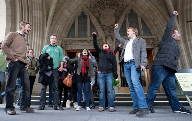 A group of youth protestors chant on the steps of the main doors to Parliament after they were escorted...