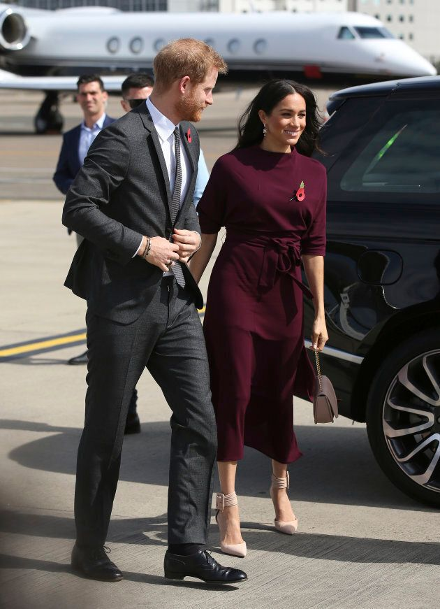 Prince Harry and Meghan Markle arrive at the airport following the Invictus Games in Sydney on Oct. 28,