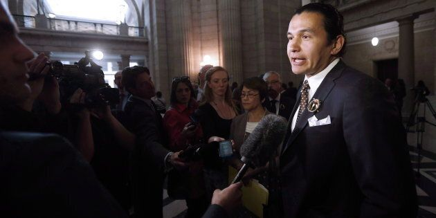 Wab Kinew speaks to media at the Manitoba legislature in Winnipeg on May 16,