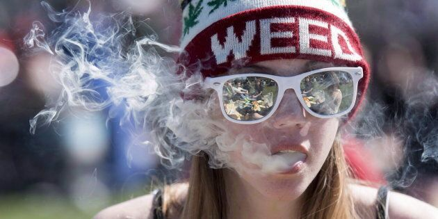 A young woman smokes a joint in Ottawa on April 20,