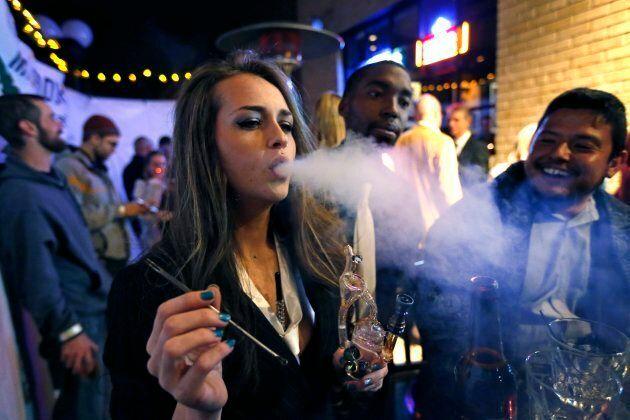 A young woman smokes marijuana on Dec. 31,