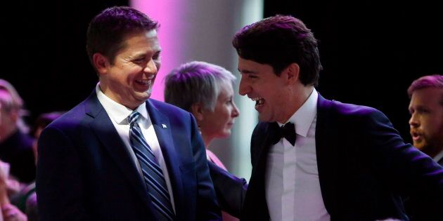Prime Minister Justin Trudeau shares a laugh with Conservative Leader Andrew Scheer at the National Press Gallery Dinner in Gatineau, Que. on June 3, 2017.