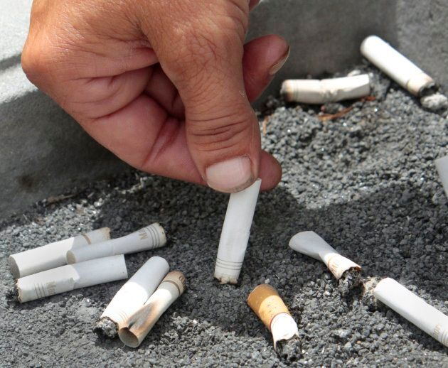 Discarded cigarette butts outside an office building on April 7,