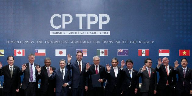 The trade ministers of 11 countries including Canada pose for an official picture after signing the rebranded...