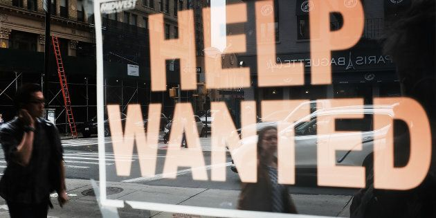 A help-wanted sign in the window of a business in Brooklyn, N.Y., Oct. 5. Canadian business are reporting a record labour shortage, but it doesn't seem to be helping Canadians find work any faster.