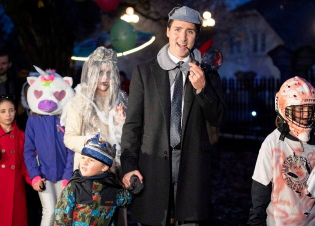 Justin Trudeau trick-or-treating with his son Hadrien at Rideau Hall.