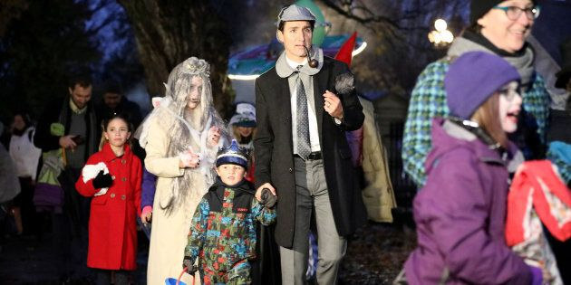 Prime Minister Justin Trudeau walks with his son Hadrien while participating in Halloween festivities...